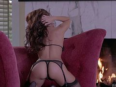 Danni Gee is a beauty with shaved pussy and perfect round boobs. Heartbreaker in black stockings shows her assets and parts her legs to fuck her hole with dildo by the fireplace.
