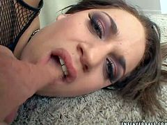Big ass brunette babe with nice hot body enjoys in giving her master a hot blowjob on her knees wearing only her fishnet stockings and a belt in the room