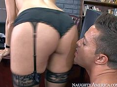 Dylan Ryder is a big boobed milf that has unthinkable sex with one of her students behind the closed door of her office. Big racked brunette in stockings gets her experienced pussy eating after sucking his young dick with passion.