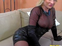 Horny and arousing blonde milf in sexy lingerie and corset enjoys in getting her shaved slit licked on the couch after shes done teasing in front of the cam