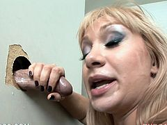 Take a look at this brutal deep throat scene where a slutty blonde takes this guy's thick cock down her throats behind a gloryhole.