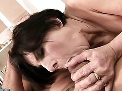 Margo T. with huge hooters lets man insert his cock in her pussy