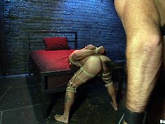 A couple of tough-looking studs, one submissive the other dominant, have some hot gay bondage sex in this scene right here.