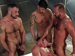Watch these manly ripped dudes get all sweaty and shit as they engage in some super hot bondage scene right here! Check it out!