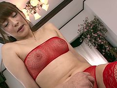 Divine Japanese babe in seductive red fishnet lingerie and stockings gets her tits aroused with vibrator before a horny dude takes a dildo to poke her cunt.