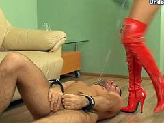 Tall chick in red latex boots dominates him