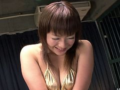 Fuckable Japanese milf in steamy golden bikini gets aroused by perverse BF. He tickles her cunt and small tits with his fingers before stimulating them with vibrators.
