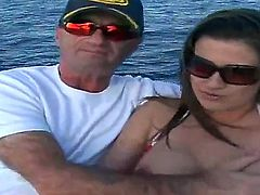The rich man seduces this luxurious big boobed hottie to give a head to him right on his yacht. She takes off bikini first of all exposing delights before sucking.