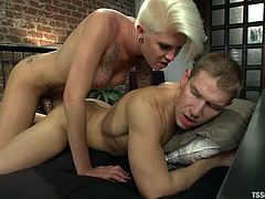Danni Daniels the hot blonde shemale fucks a guy in his mouth and sucks his dick. After that gets ass fucked on a bed.