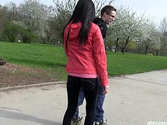 Attractive brunette girl Monika is chilling with her boy in the park. He teaches her to ride rolls. They sit on a bench kissing passionately in a french way.