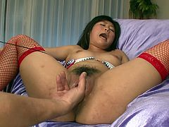 Hot blooded Japanese hoe lies on her back wearing steamy red fishnet stockings while getting her soaking wet pussy drilled with dildo and her clit stimulated with vibrator in sultry sex video by Jav HD.