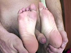 Sophie Lynx has her feet licked and her toes sucked before she gives this guy a proper footjob. She also deepthroats his cock.