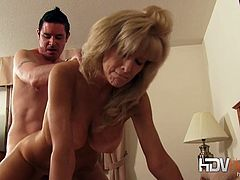 Come and see the perverse mature blonde Cam Ray blowing a young stud's cock in this hardcore video set by HDV Hardcore. Then she's ready for her pussy to be banged balls deep into a mind-blowing orgasm.