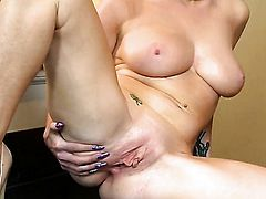Georgie Lyall with massive tits and hairless twat shows her love for pussy stroking