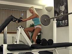 Sporty horn-mad zealous gal Evelyn masturbates with a dildo after the training