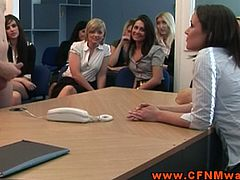 This brunette sucks this guy's cock while her dominant female friends watch her and comment on what she's doing.