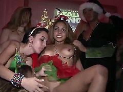 Good looking young pornstars Ava Cash, Jmac, Kimberly and Rahyndee with hot bodies get naked during Christmas party and fuck with each other all over the place in memorable orgy.