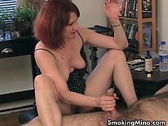 There is always something sexy about chicks smoking cigarettes! Watch Mina the busty whore jerking off a big cock while smoking one!