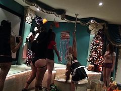 This Christmas party is full of nasty sluts. There is a stripper pole next to the Christmas tree and the sluts take turns pole dancing. One of the dirty sluts grinds her sweet ass on a guy wearing a monkey mask. Another girl bends over and gets her pussy fingered from behind.