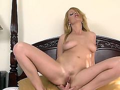 Smoking hot blonde bombshell Carmen Gemini with heavy make up and big juicy tits gets naked and stretches her fish lips wide while teasing her lover in point of view.