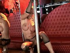 Arousing smoking hot blonde stripper Harmony Flame with big fake hooters and hot body in ripped pantyhose and high heels teases and plays with glass toy by the pole.