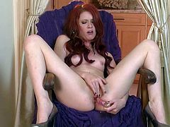 Elle Alexandra is a tender babe with red hair and pale white skin. She spreads her legs wide and sticks glass dildo in her dripping wet pink hole. She dildos her vagina for you to watch!