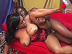 Black beauty Kim Eternity uses her hairy pussy to bring her hunky man to a messy orgasm all over her