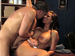This impressively busty babe has a steamy pussy fuck with her boss. They're doing it at the office, on his desk.