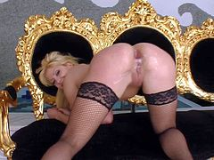 Young pretty blonde babe Lia with natural boobs and long legs in stockings only gets her tight holes boned balls deep by two studs in hardcore threesome in living room