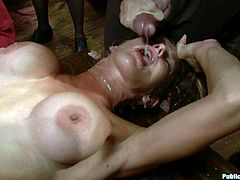 A fucking whore gets tied up with ropes and fucked hard in this kinky bondage scene with people watching as it goes down.