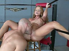 Long haired arousing bombshell Nikki Delano with french manicure and big firm hooters gets naked while teasing muscled Johnny Sins and fucks with him like a pro in the ring.