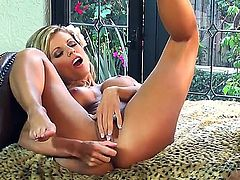 A skinny blonde uses a purple toy on her box