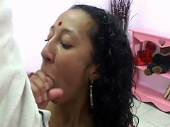 Seductive Indian slut gets seduced by a blind dude. He tongue fucks her delicious shaved vagina before she kneels down to give him a steamy blowjob.
