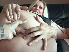 Julia Ann is s curvy blonde milf with big ass. Woman in nylons shows off her big round buttocks as she gets her loose pussy and anal hole dildo fucked from your point of view.