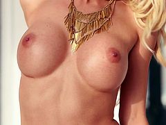 Sexy blonde Kyara Tyler takes her lingerie off and demonstrates her big fake tits. She strokes her body passionately and then moves her legs wide apart and exposes her cute pussy.