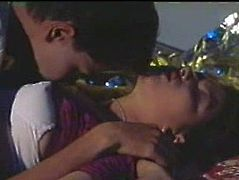 Black haired beauty from Indian looks cute in her purple sari. One guy kisses her big tits and licks her breasts with great pleasure.