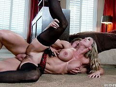 Brandi Love is a blonde stunner with big tits. She goes wild in the bedroom and fucks this guy on the floor.
