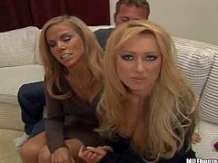 MILF Hunter has a nice time with two attractive long haired blondes. They drink wine and then turn him on. They kiss in front of him and flash their pussies on the couch.
