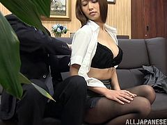 Cute Japanese secretary Mako Higashio is having fun with her boss indoors. She rubs his hard cock devotedly and then shows her amazing cock-sucking skills.