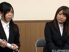 Three Japanese chicks wearing office clothes are having fun indoors. They rub their vags with dildos and moan loudly with pleasure.