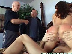 Check out this hot brunette wifey having some fun in front of her hubby. She got her throat banged and then took it in her pussy!