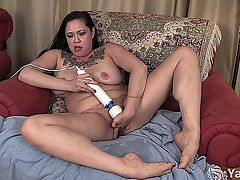 Shameless tattooed MILF Eden Alexander pleasing her meaty pussy with a vibrator