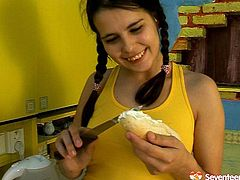 She is silly teen with braided ponytails, big boobs and hairy pussy. She is seduced by horny mature stud. So he mouth fucks her in the kitchen. Later he bangs her bearded clam from behind in standing position.