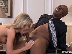 It's an interracial porn video and the one getting the big black cock in her pussy and asshole is the blonde Amy Brooke.