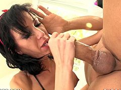 Petite brunette girl massages her boobs and fondles the pussy. After that she comes up to a guy and blows his dick passionately.
