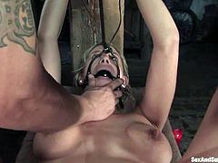Busty blondie Kylie Worthy gets tied and face fucked