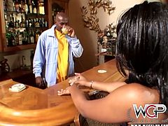 Beefy black dude hooks up with a peppering black babe for a hot sex session. He pounds her in missionary style before she steps outside to strip by the pool in sultry sex video by WCP club.
