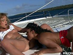 Kathy Campbel and Lucy Belle eat each other's vags on a yacht