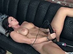 Big tittied brunette chick strips her clothes off in a living room and sits down on a sofa. She spreads her legs and gets her vagina toyed by the fucking machine.