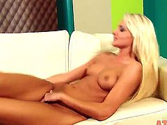 Blonde Ivana Sugar with small tities and clean muff has fire in her eyes as she masturbates